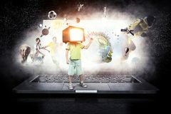 TV addicted children. Mixed media. Kid boy with TV monitor for his head. Mixed media Royalty Free Stock Photography