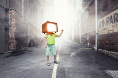 TV addicted children. Mixed media Royalty Free Stock Photography