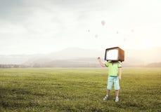 TV addicted children. Mixed media Stock Photo