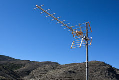 TV Aerial. With mountains and blue sky as background stock photos