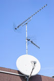 TV aerial and satellite dish Stock Photography