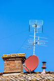 TV aerial and satellite dish Stock Photo