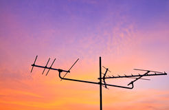 TV antenna. Silhouetted of a television antenna with morning light Stock Photo