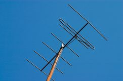 TV antenna. TV anntenna on blue sky background Royalty Free Stock Photography