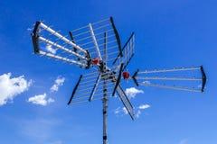 Tv antenna against blue sky Stock Image