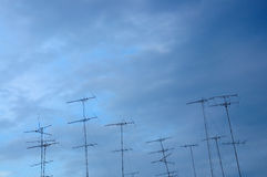 TV antenna on blue sky Royalty Free Stock Photography