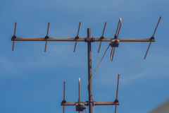 TV antenna with blue sky. Royalty Free Stock Photo