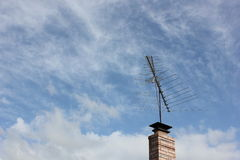 TV antenna on brick chimney Royalty Free Stock Images