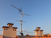 Tv antenna and chimney Royalty Free Stock Images