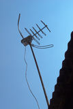TV antenna on corrugated roof Royalty Free Stock Images