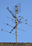 TV antenna with farmer swallows. Royalty Free Stock Photos