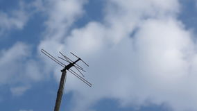 TV Antenna. Old style TV antenna and clouds, time-lapse stock video