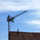 TV antenna over old roof Stock Photography