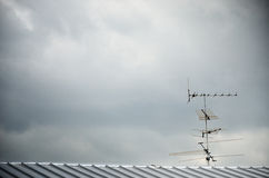 TV antenna on roof Royalty Free Stock Image