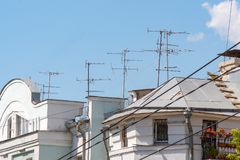 TV Antenna on the roof of the house against blue sky. TV Antenna on the roof of the house against the blue sky Royalty Free Stock Photo