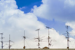 TV antenna on the roof of the sky with clouds. TV antenna on the roof of the sky with clouds Royalty Free Stock Images