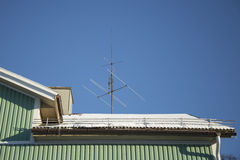 TV Antenna on Snow Covered Roof Royalty Free Stock Photography