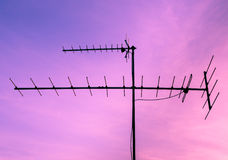 TV antenna at sunrise sky Royalty Free Stock Photo