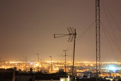 TV antennas, with a city background Stock Photo