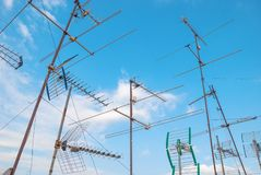 TV antennas. Of various shapes on the roof against the sky royalty free stock image
