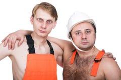 två arbetare Arkivfoton
