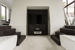 TV area of a house. TV area of a modern house with sofas on either side Royalty Free Stock Photos