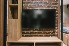 TV with blank screen and shelf cabinet at night, interior design royalty free stock photo