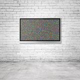 TV on brick wall. Wide screen TV on brick wall in room Royalty Free Stock Photo