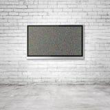 TV on brick wall Royalty Free Stock Photo