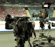 TV broadcast hockey, TV camera,. Professional camcorder to broadcast hockey, TV camera Stock Image