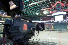 TV broadcast hockey, TV camera,. Professional camcorder to broadcast hockey, TV camera Royalty Free Stock Image