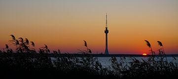 TV broadcast tower silhouette at sunset Techirghiol Eforie Constanta Romania