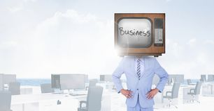 TV on businessman`s head with business written on screen Royalty Free Stock Photography