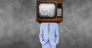 TV on businessman`s head displaying gears. Digital composite of TV on businessman`s head displaying gears royalty free stock photography
