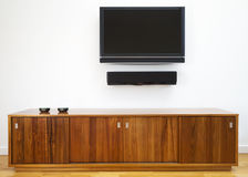 TV and cabinet horizontal. Wall mounted TV and cabinet underneath Royalty Free Stock Image