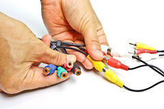 Tv cable jack. Hands holding tv cable jack stock photography