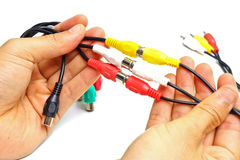 Tv cable jack. Hands holding tv cable jack stock image