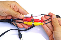 Tv cable jack. Hands holding tv cable jack royalty free stock photos