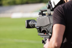 Tv camera broadcasting during a football (soccer) match Royalty Free Stock Photos