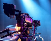 Tv camera in a concert hal. Royalty Free Stock Image