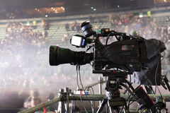 Tv camera in a concert hal. Professional digital video camera. Stock Photography