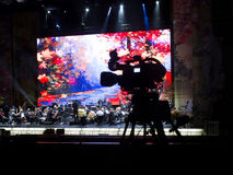 Tv camera in a concert hal. Professional digital video camera. Stock Image