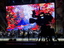 Tv camera in a concert hal. Professional digital video camera. Royalty Free Stock Image