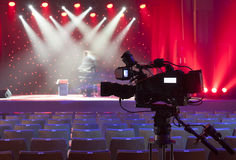 Tv camera in a concert hall. Royalty Free Stock Photography