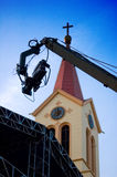 TV camera crane. TV camera on the crane and with the church in the background royalty free stock photography