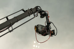 TV camera on a crane on football mach or concert Royalty Free Stock Images