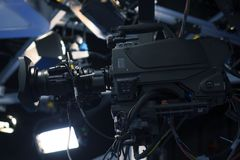 Broadcast television studio camera and crane camera in news studio room royalty free stock photos