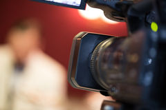 Tv camera look from behind Stock Image