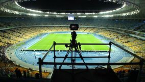TV camera shooting stadium sport event, football match broadcast. Stock footage stock video footage