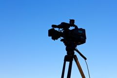 Tv camera. And video tripod against blue sky Royalty Free Stock Image